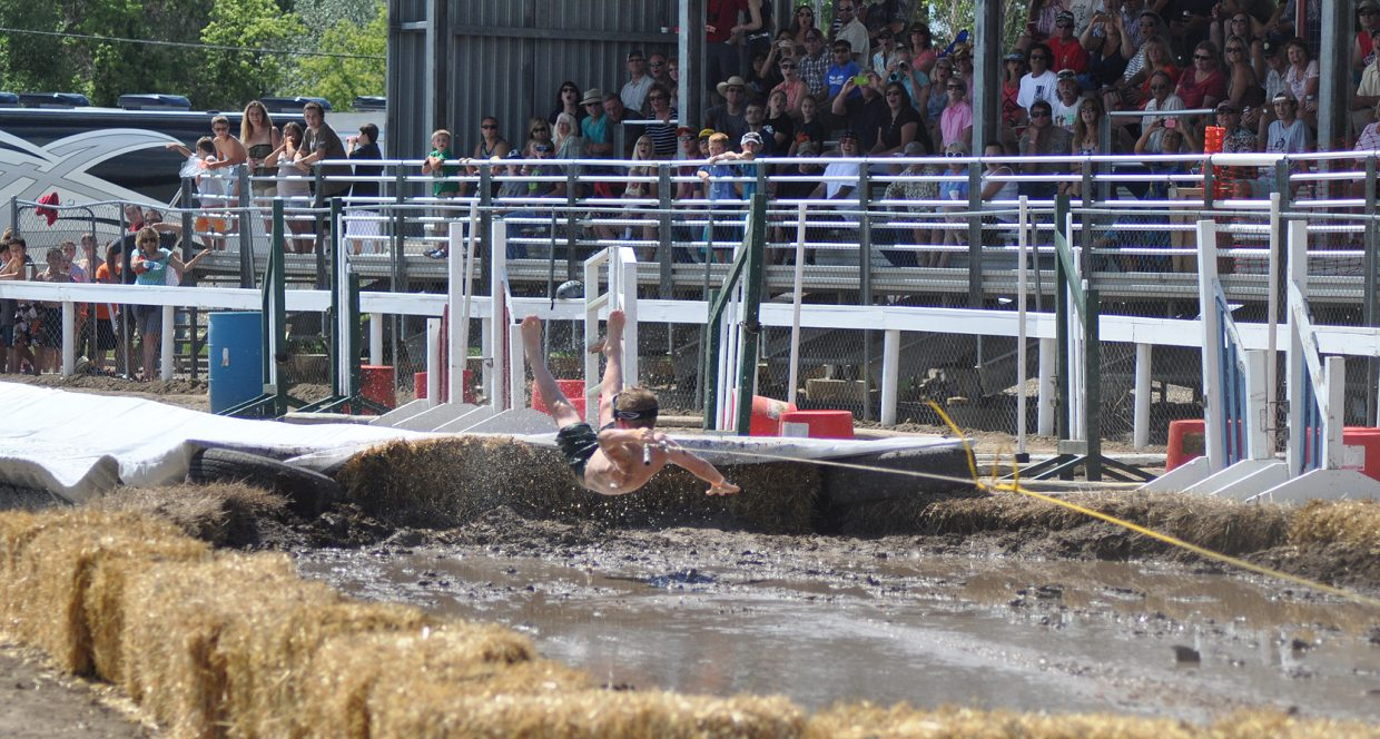 A youth mudsurfer goes off the jump backwards at the the 2014 Routt County RedneX Games in Hayden, Colorado. Submitted by: Wendy Lind