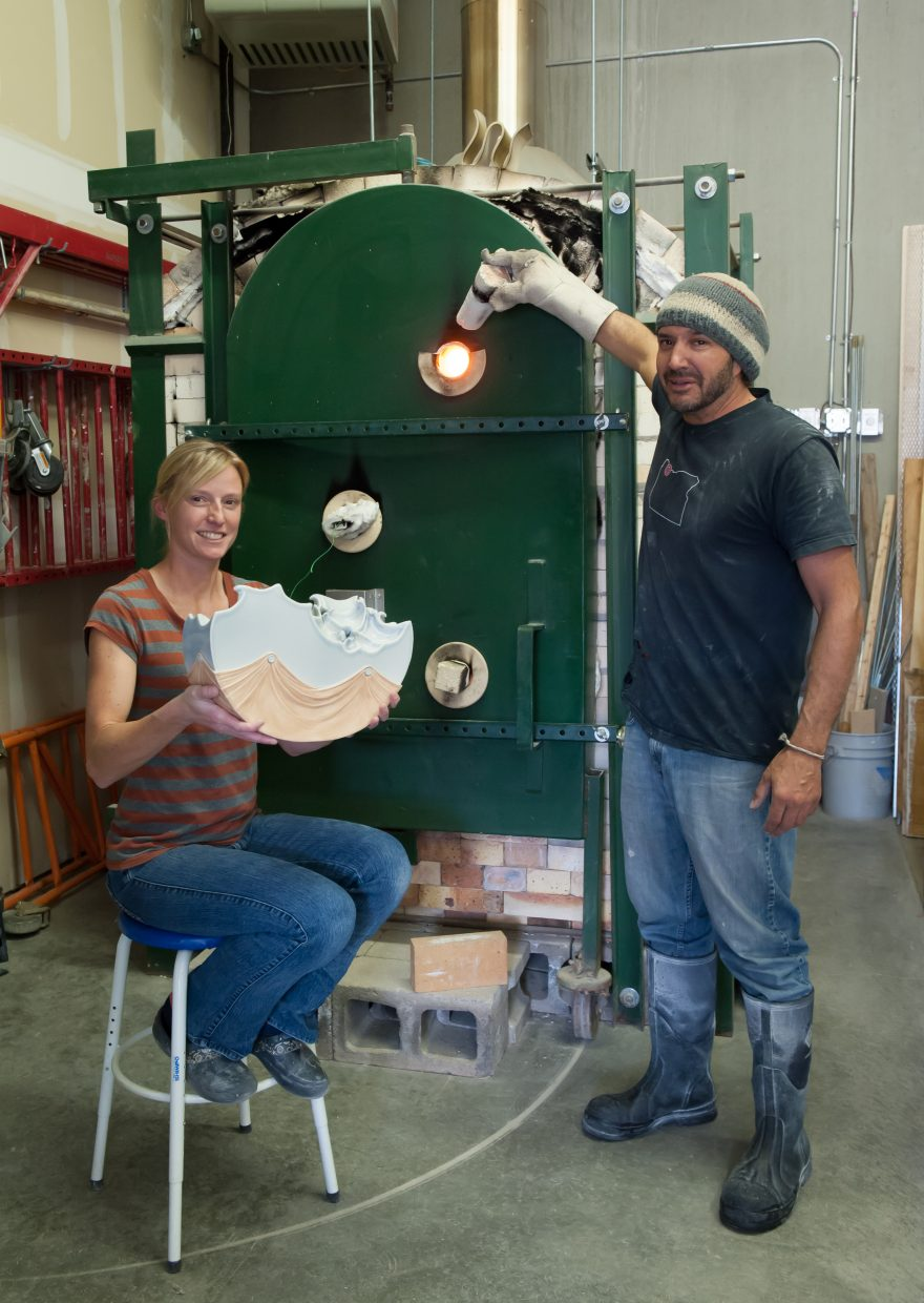 Julie Anderson and Greg Grasso check the fire in their one-of-a-kind ceramics kiln designed and built in Steamboat Springs. The couple is hosting a grand opening happy hour for their new classroom space from 5 to 8 p.m. Saturday, Aug. 20 at Warehome Studios, 2520 Copper Ridge Dr.