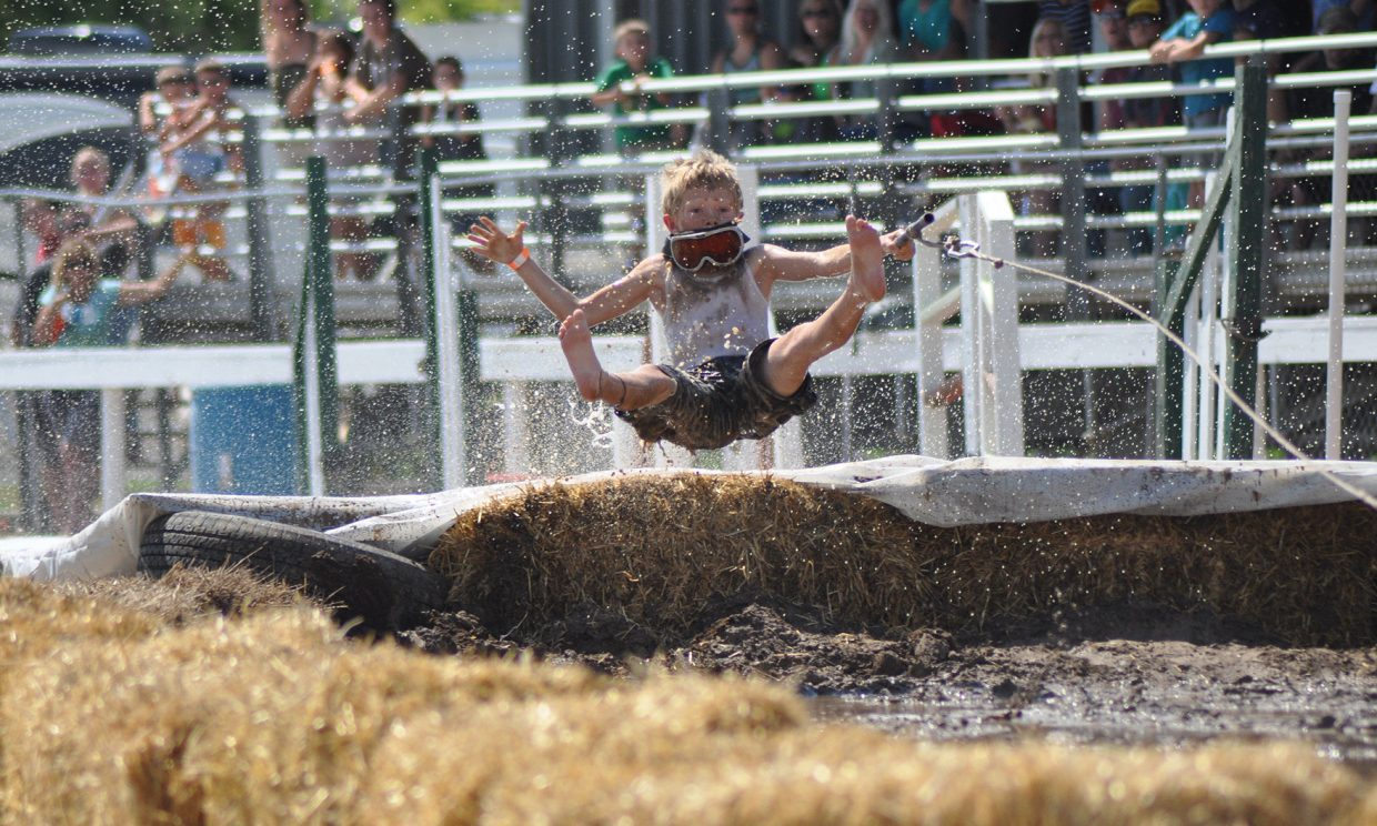 A youth mudsurfer enters the mud pit at the at the 2014 Routt County RedneX Games in Hayden, Colorado. Submitted by: Wendy Lind