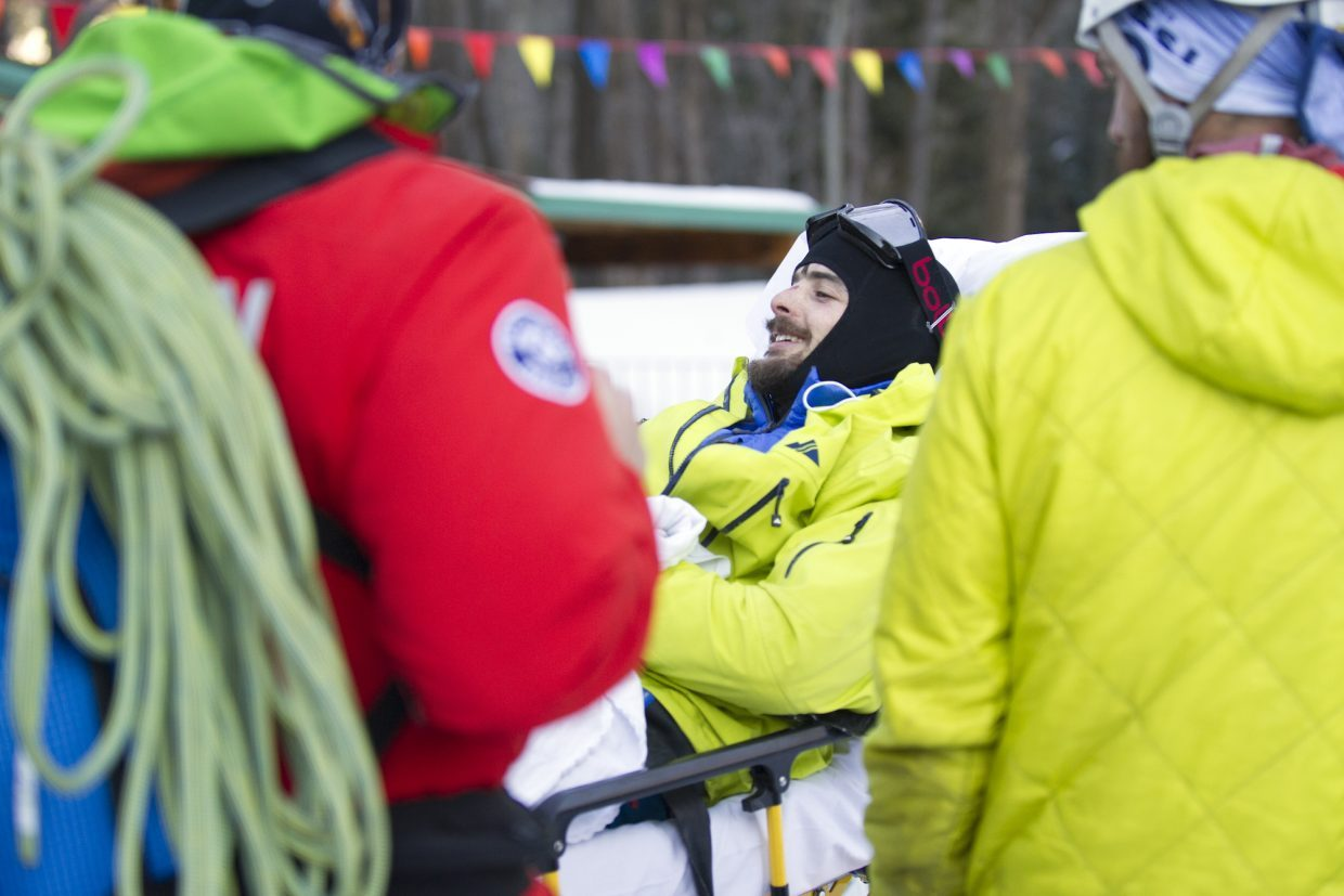 Ryan Montoya, who has been missing since Sunday night, is loaded into an ambulance Tuesday afternoon after being found by searchers. Montoya, 23, of Boulder was reported missing Sunday night and spent the past two days alone.