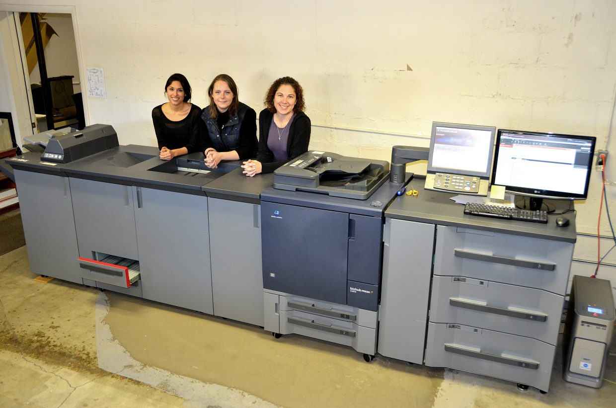 Designers Janette Najera, Julia Perry and Lindsay Porter with the new Konica Minolta printer.