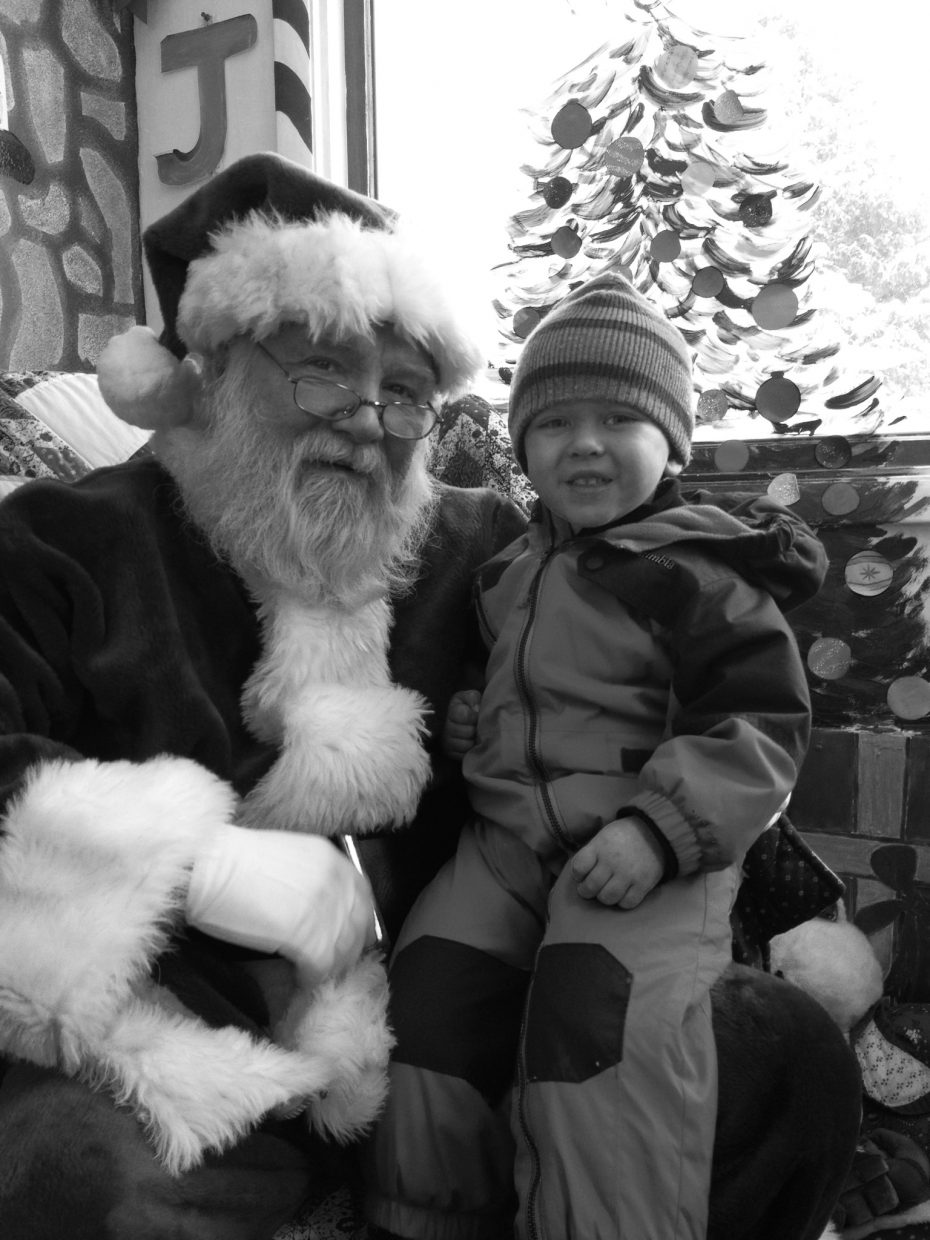 Photo of Kyler Maughan and Santa. Submitted by: Crystal Maughan