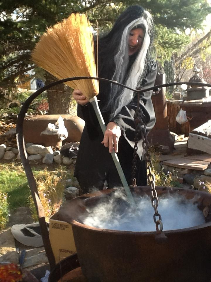 Stirring the Gummy Bear soup at the Fairview witch fiesta. (Mary O'Brien) Submitted by: Irene Nelson