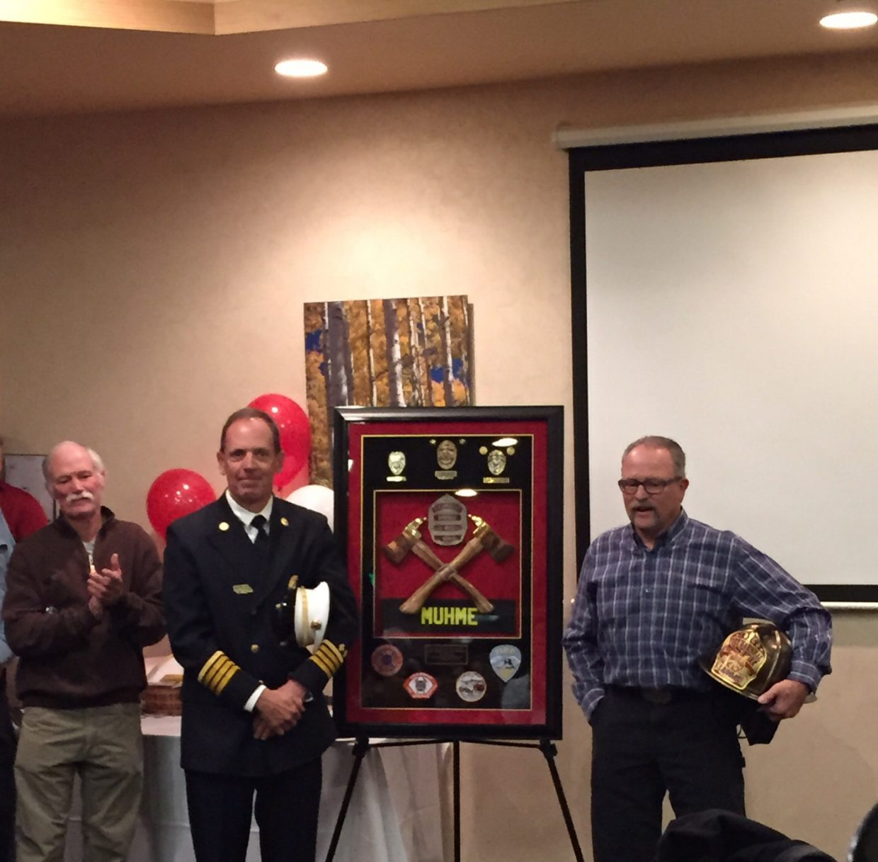 Steamboat Fire Marshal Jay Muhme's retirement party. Submitted by: Craig Malchow