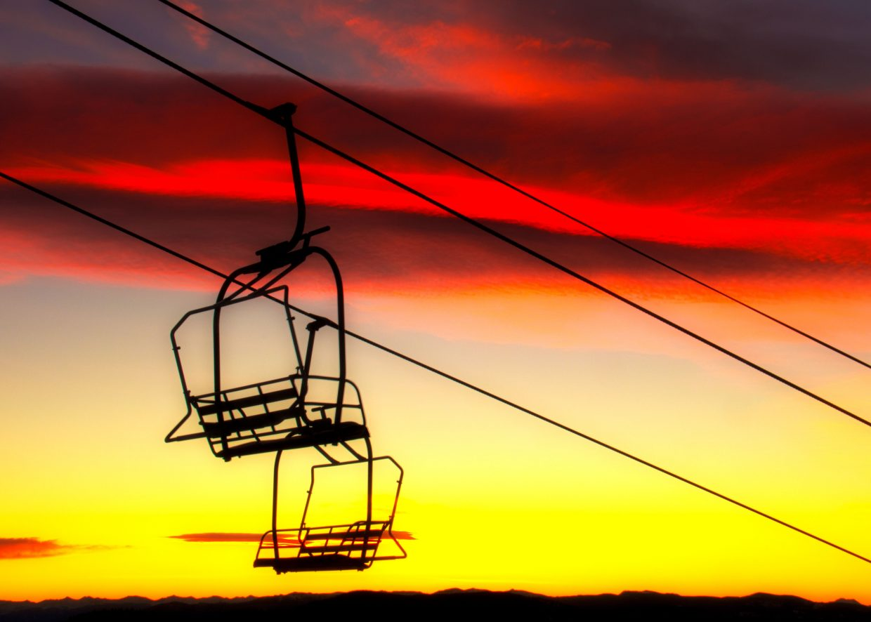 The top of Morning Side chair lift at steamboat ski area during sunrise. The mountains in the background are the Gore and Indian peaks. Settings: f29, 1/4, ISO100, 35mm: f29, 1/10, ISO100, 35mm. Submitted by Brendan Durrum.