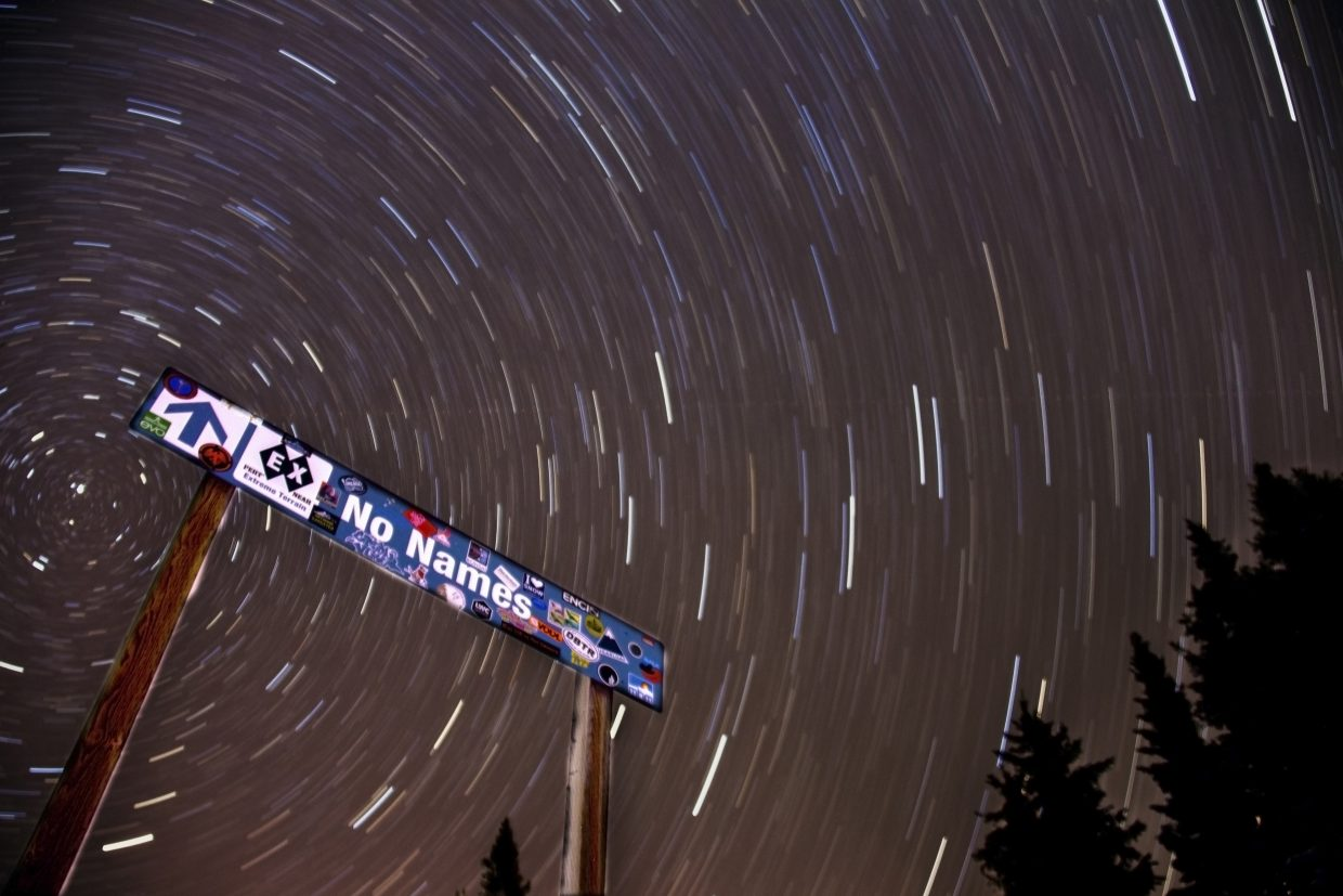 """A very long exposure of the stars circling the north star behind the trail sign for no names. Settings: 30min, f3.5, ISO400, 18mm."" Submitted by Brendan Durrum."