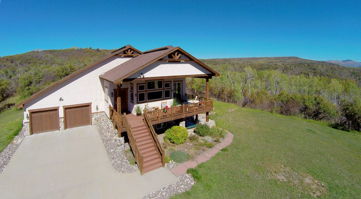 """Brokers Jack and Diane Carter listed this home on Timber Ridge Drive in the south valley three years ago, and gradually lowered the listing price to reach the """"sweet spot"""" where buyer demand led to four offers at once."""