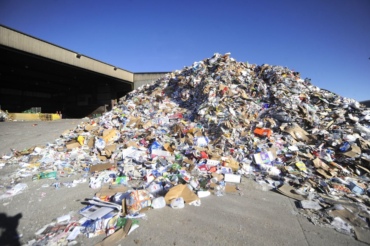 A mound of single-stream recycling sits in the yard at Waste Management's Franklin Street materials recovery facility.