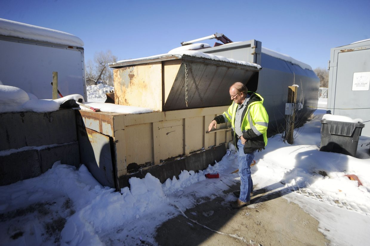 Steve Weinland, owner of Aces High Services, explains how he compacts single-stream recycling before shipping it to Denver.