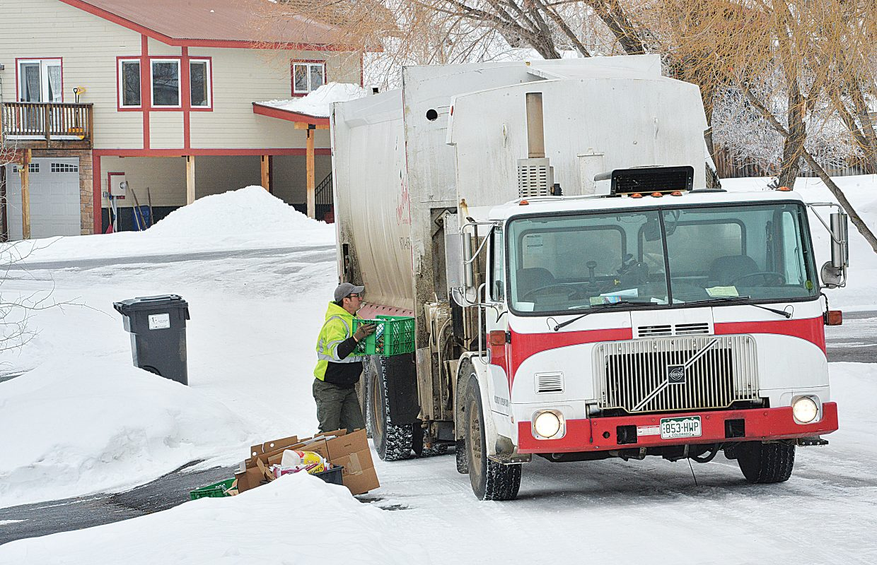 Eric Rodriguez collects recycling for Ace's High Services in the Steamboat II neighborhood.