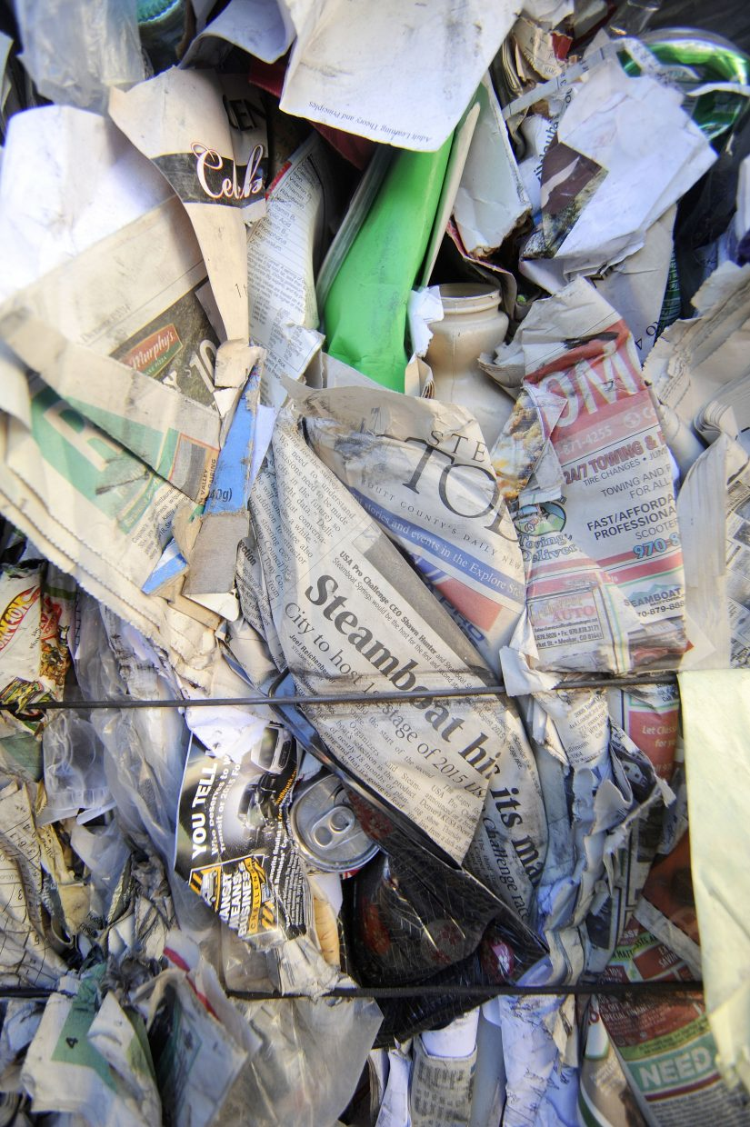 Bales of single-stream recycling sit in the yard at Waste Management's Franklin Street materials recovery facility.