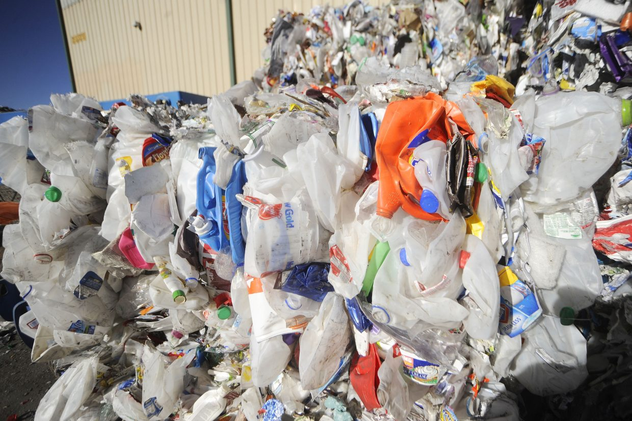 Bales of sorted plastic containers sit in the yard at Waste Management's Franklin Street materials recovery facility.