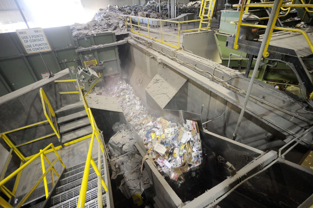 Unsorted single-stream recycling enters Waste Management's Franklin Street materials recovery facility.