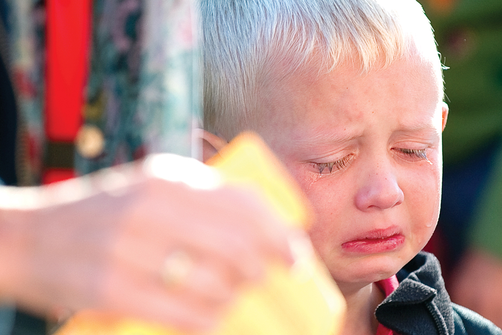 Lucas Reymore was missing his mom as he waits outside Soda Creek Elementary School on the first day of kindergarten classes in Steamboat Springs. The photograph was taken by John F. Russell and appeared in the Aug. 27, 2010, edition of the Steamboat Today.