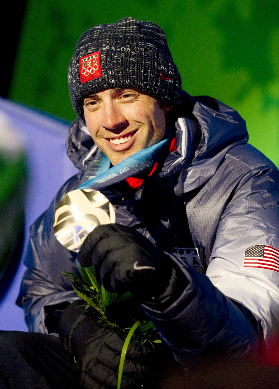 Johnny Spillane shows off his silver medal at the 2010 Winter Olympics. His win ended the U.S.'s 86-year Nordic combined drought at the Olympics. The photograph was taken by John F. Russell and appeared in the Feb. 14, 2010, edition of the Steamboat Today.