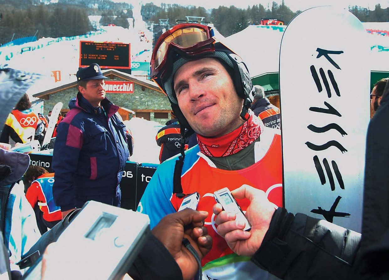 Tyler Jewell, who trained and lived in Steamboat Springs leading up to the 2006 Olympics in Italy, is flooded by reporters following his finish in the qualifying round of the Alpine snowboarding event at the 2006 Winter Olympics. The photograph was taken by John F. Russell and appeared in the Feb. 22, 2006, edition of the Steamboat Today.