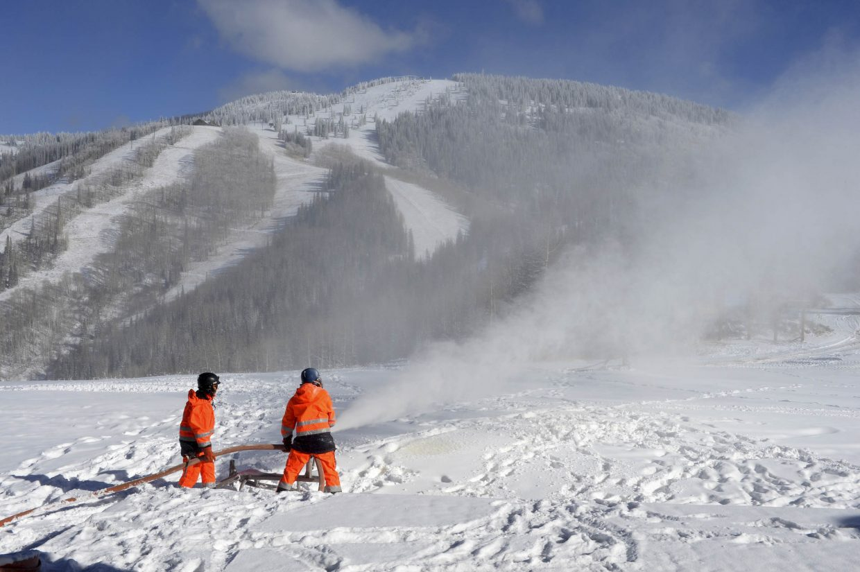Snowmakers blow snow Tuesday at Steamboat Ski Area.