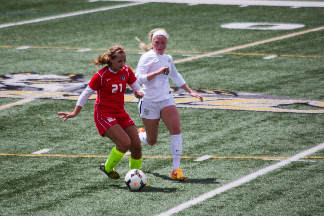 Steamboat Springs' Lauren Anderson evades a Battle Creek defender during Saturday's second round state soccer playoff game in Edwards. Battle Creek won the match 3-2.