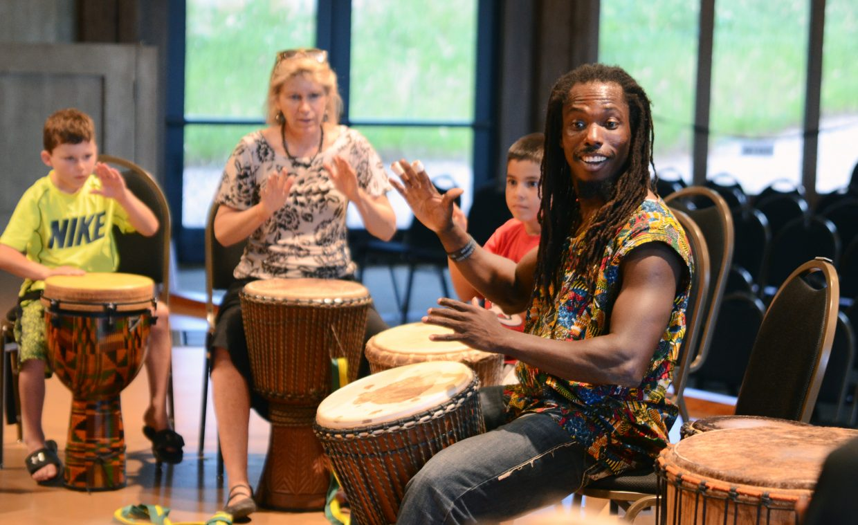 Fara Tolno teaching a djembe drum class Monday evening at the Strings Pavilion.