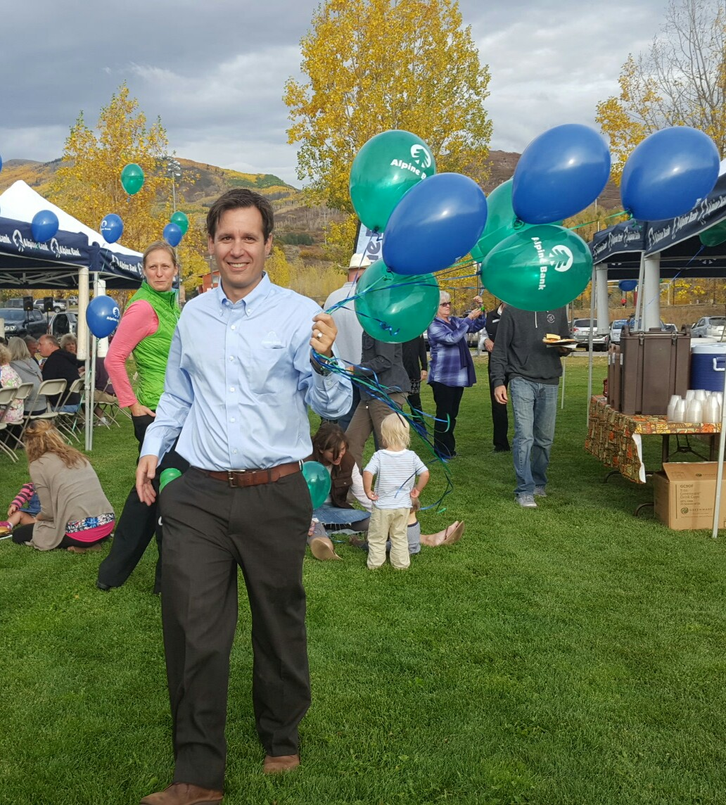 Timothy Haley of Alpine Bank distributes balloons during the barbecue.
