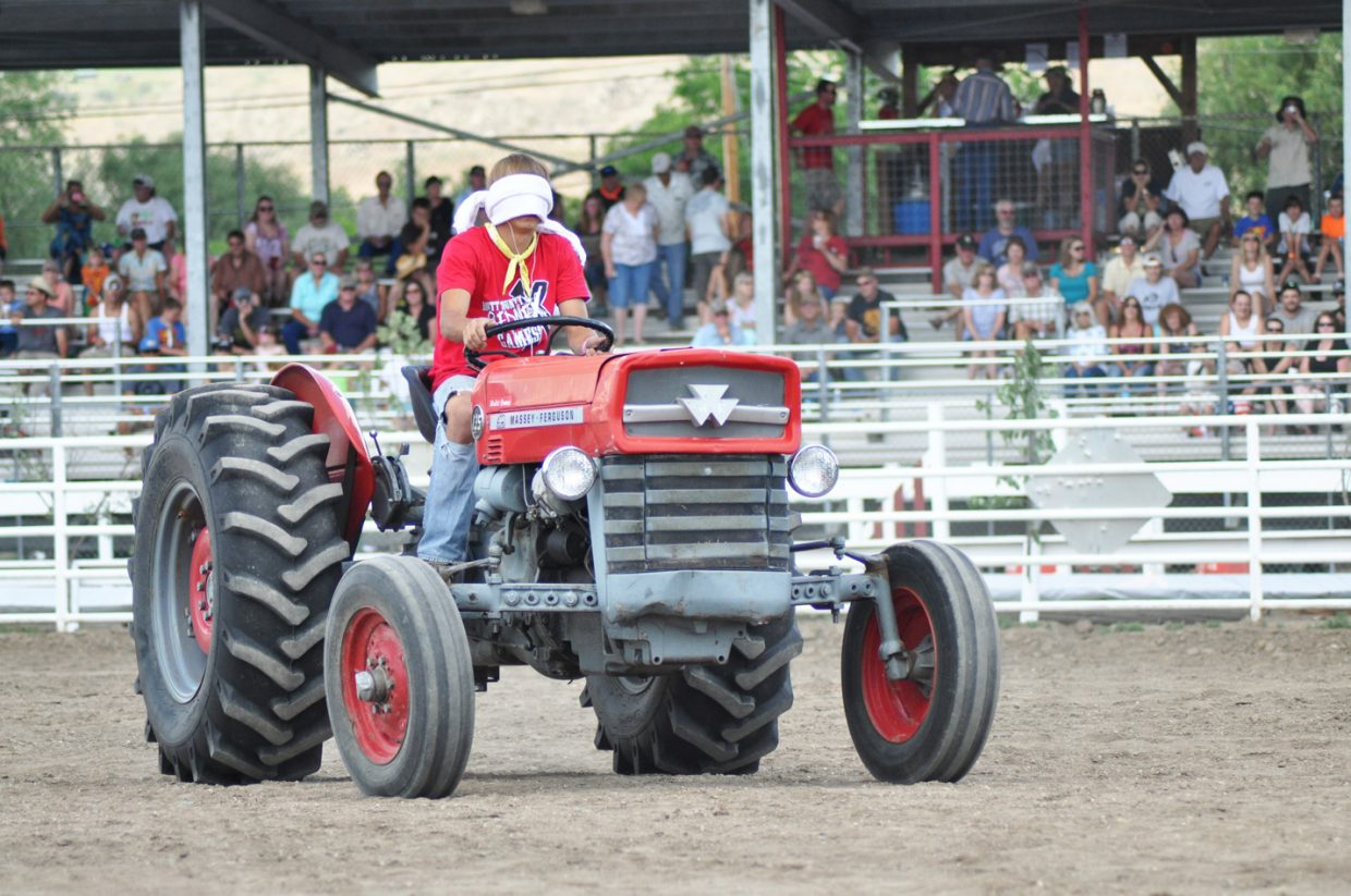 A competitor in the Blind Tractor Driving event at the 2014 Routt County RedneX Games in Hayden, Colorado. Submitted by: Wendy Lind