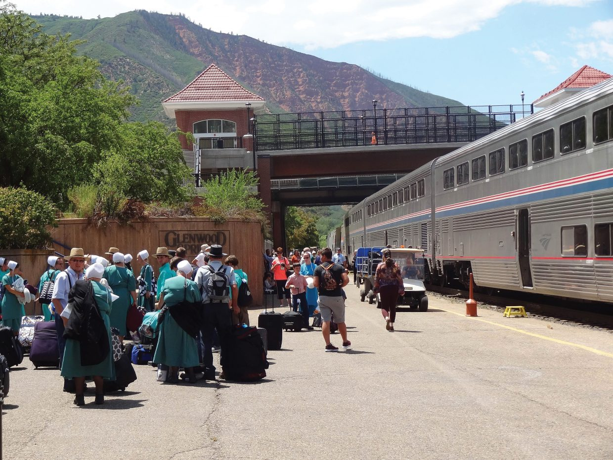 Members of the Amish community unload from the California Zephyr after it pulls in the Glenwood Springs Amtrak station.