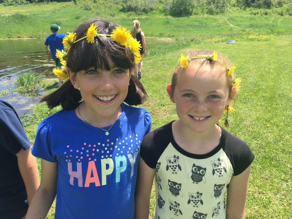 Fourth grade friends with flowers on a Field Trip at the Jenkins Ranch. Submitted by Marianne Capra.