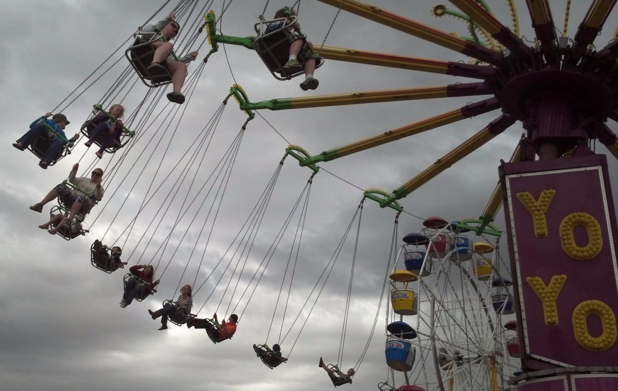 "Riders on the ""Yo Yo"" having fun, despite the cloudy sky, Sunday afternoon at the Steamboat Springs Carnival. Submitted by Ted Carleton."
