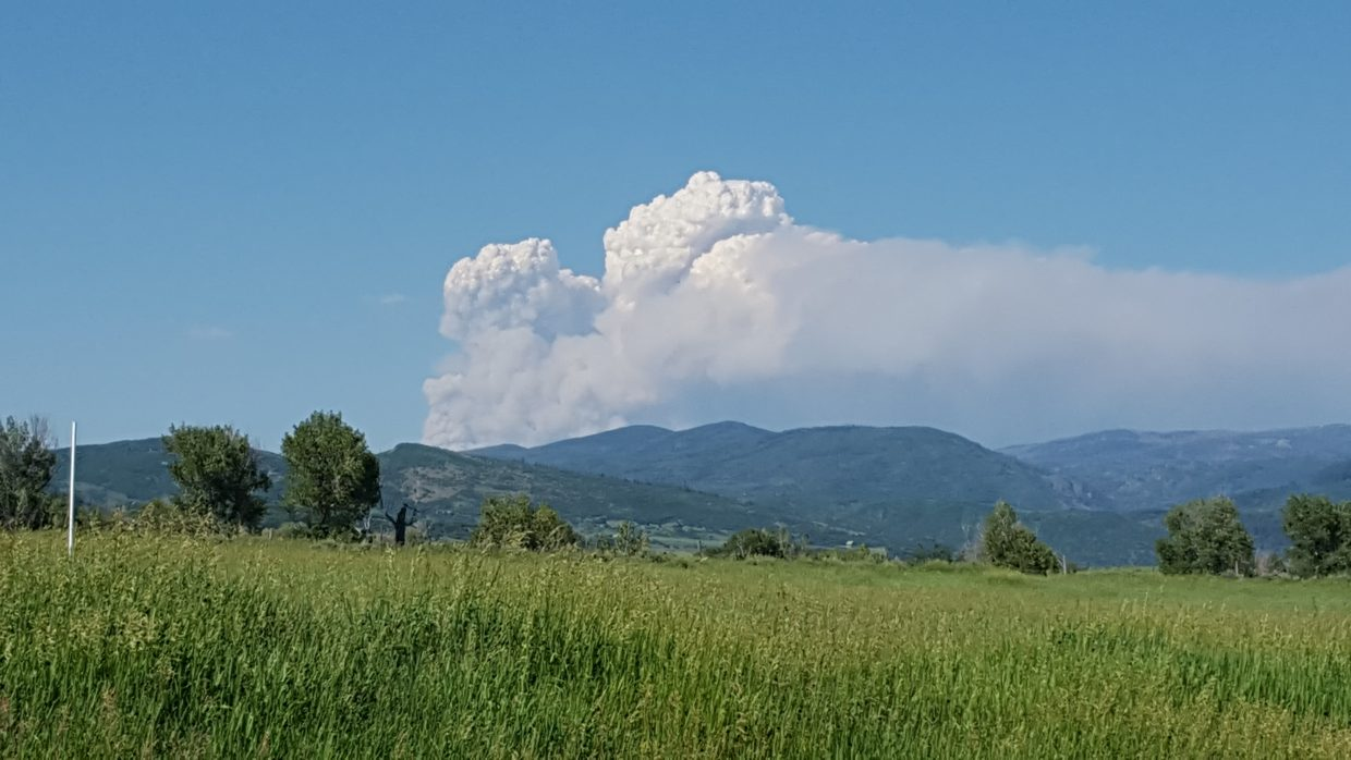 Billowing cloud in a cloudless sky...the Beaver Creek fire as seen from Routt County Road 42. Submitted by Sherry Yates.