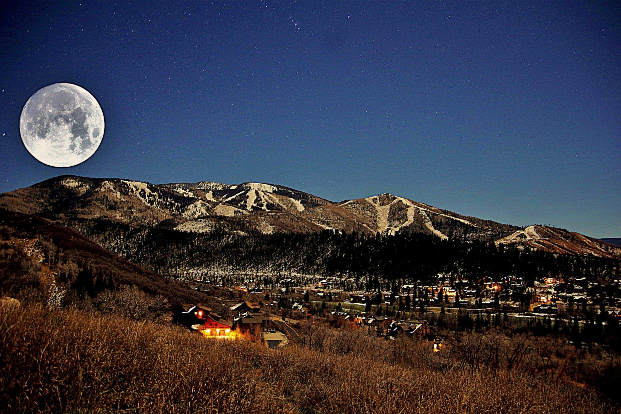 The moon rising over Mt. Werner. Submitted by: Matt Helm.