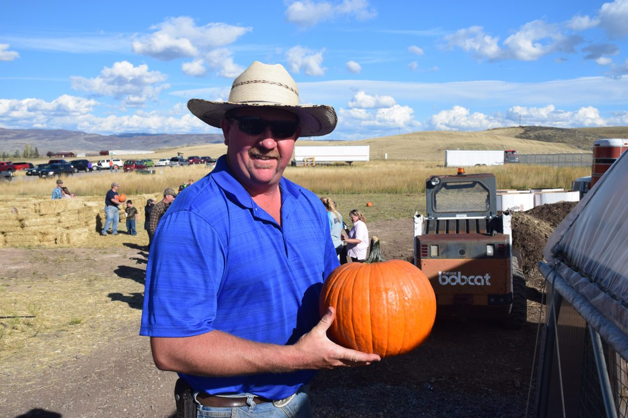 Frank Case holds a pumpkin high at the Harvest Festival hosted by Frank and Monica Case together with the Hayden Parks and Rec Board on Saturday. Submitted by David Torgler.