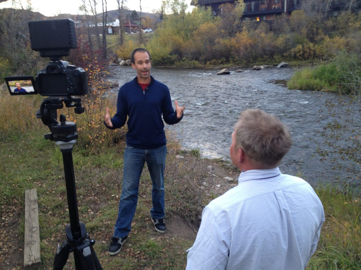 """Cody Perry and Ben Saheb interview Kent Vertrees (board member of Friends of the Yampa) in downtown Steamboat Springs. The shot is part of Rig to Flip's film """"Warm Springs."""" It will premiere at 7:30 p.m. Friday at Schmiggity's."""