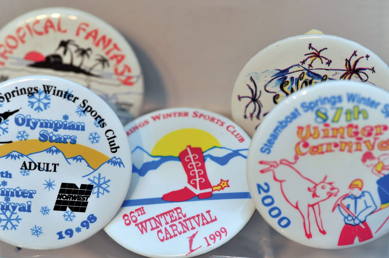 Buttons from Winter Carnivals from past years on display at the Tread of Pioneers museum in 2013. Submissions for the 2016 Winter Carnival button are due by 5 p.m. Monday.