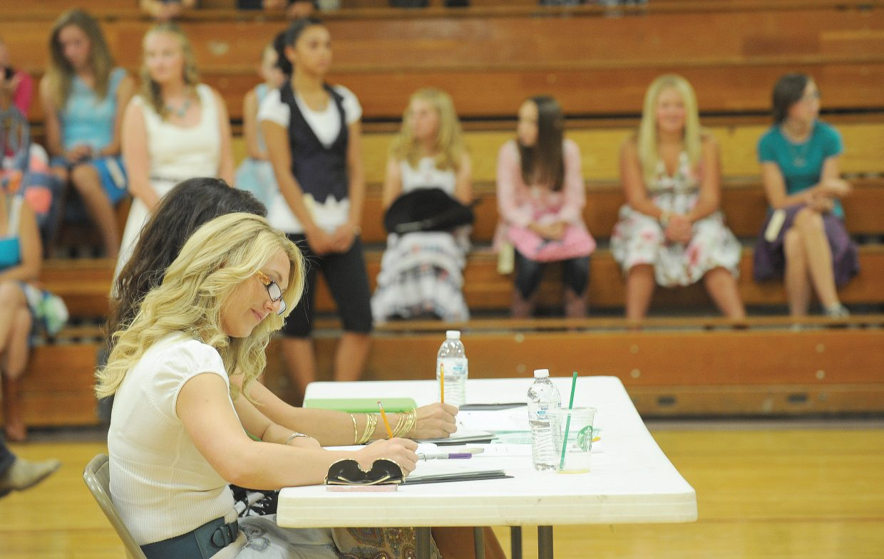 Judges take notes during the 4-H fashion Revue Friday afternoon inside the Soroco gym.