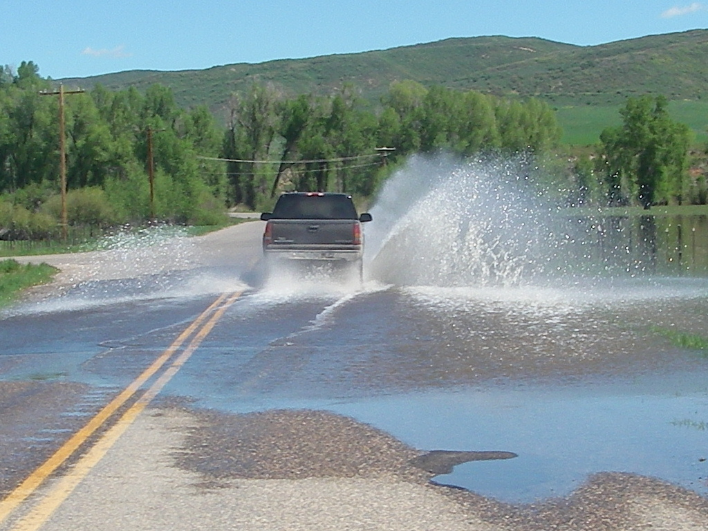 The Yampa River spilled over the road Tuesday morning at Routt County Road 179.