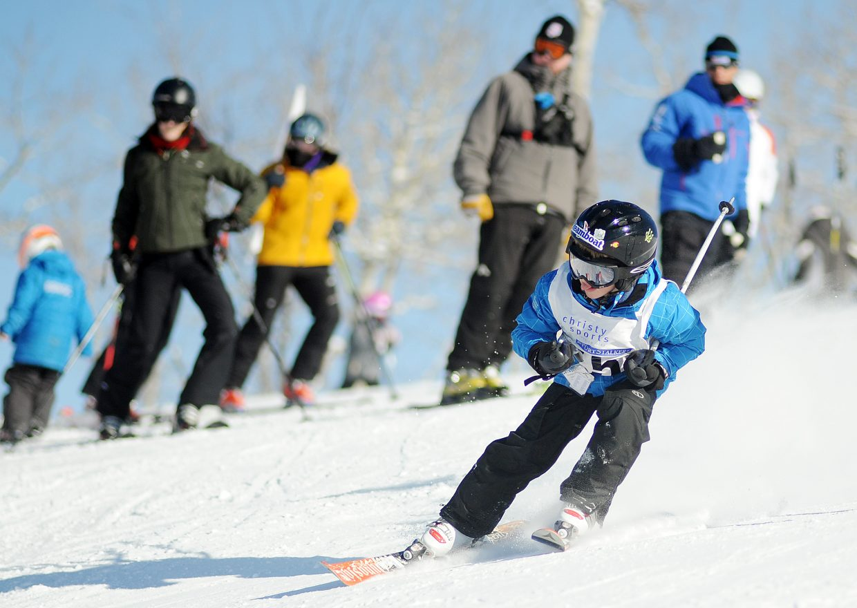 J6 boys skier Alden Wade, 7, sticks out his tongue Sunday as he cuts to make a turn on the Sitz/See Me giant slalom course at Steamboat Ski Area during a Steamboat Cup race. More than 100 young racers from the Steamboat Springs Winter Sports Club took part in the event. Read the full story on page 16.
