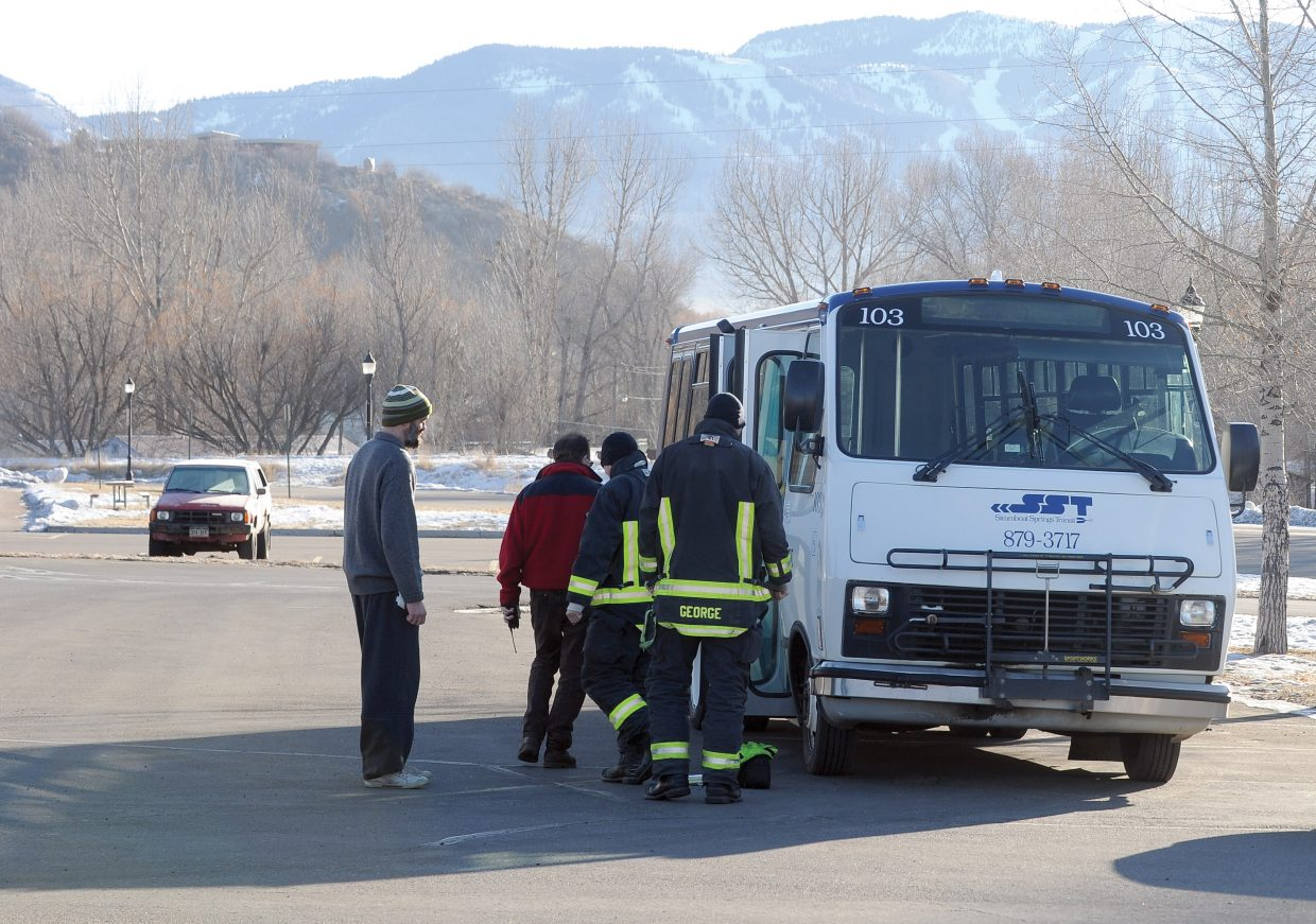 Bus driver Bill Blackwell waits while supervisor Mark Woolers shows firefighters from Steamboat Springs Fire Rescue the area where a small electrical fire broke out on a Steamboat Springs Transit Bus on Monday morning. Blackwell said he was visiting with another bus driver and a passenger outside the bus during a stop when he noticed smoke in the cab of the vehicle. He returned to the bus where he noticed flames coming from an electrical box near the driver's seat. He was able to remove a cover of the box, grab a fire extinguisher nearby, and put the fire out before it could cause further damage. The bus was pulled off its route, and another bus was added and the line was back to normal service after an estimated 30-minute delay, according to Woolers. Woolers felt that the damage to the bus was substantial, but no estimates were available at the scene.