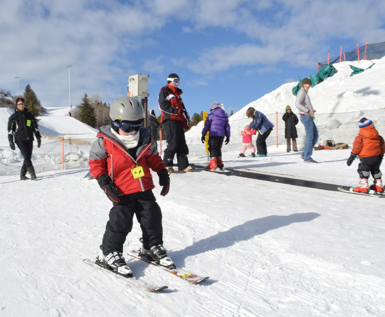 Charlie Wright, 4, was among the youngsters learning to ski on his own two feet at the magic carpet slope at Howelsen Hill on New Year's Day.