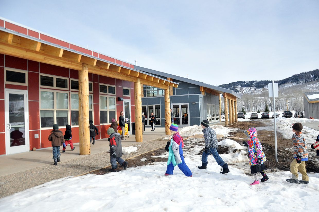 Students line up to leave recess Wednesday outside North Routt Community Charter School's new building. Students started classes in the new building Wednesday.