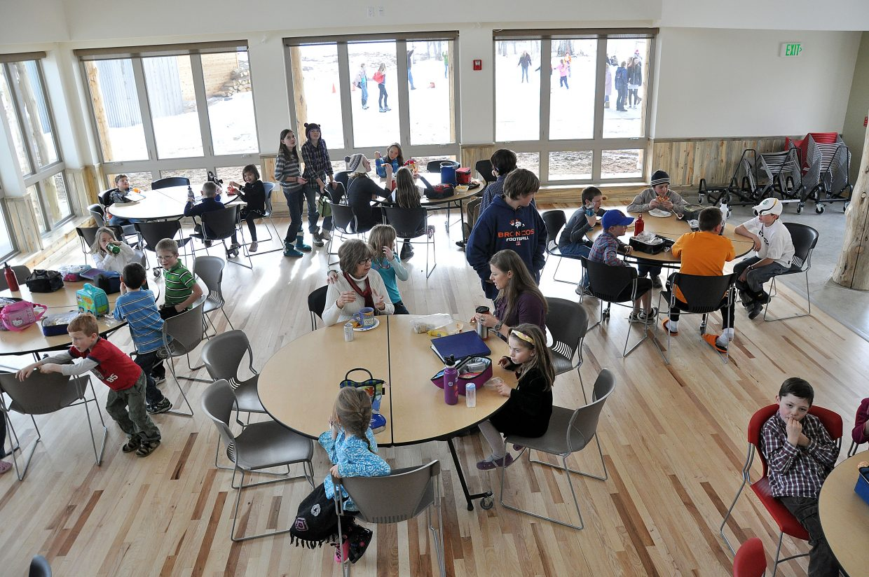 Students eat lunch inside the cafeteria of North Routt Community Charter School's new campus.