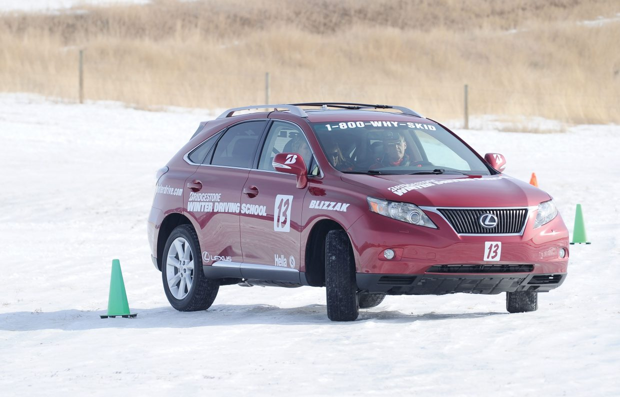 Operations manager Kurt Spitzner drives through an accident avoidance exercise at the Bridgestone Winter Driving School.