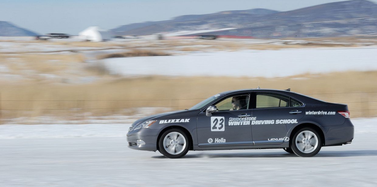 Ava King races along an icy track at the Bridgestone Winter Driving School a few seconds before slamming on the brakes in an effort to make a controlled stop. Students are taught the best way to deal with less than ideal conditions many of us face during the winter.