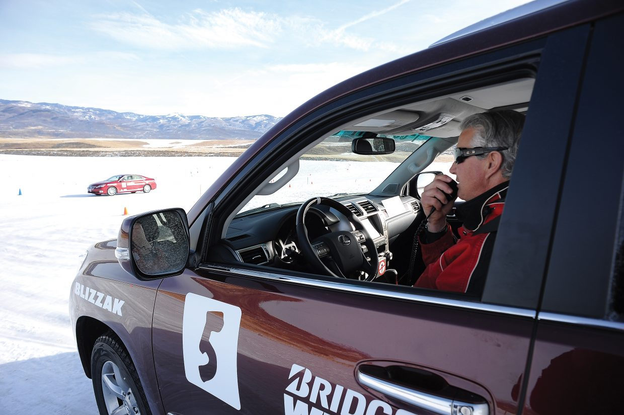 Bridgestone Winter Driving School instructor Morgan Kavanaugh uses a radio to talk to students during a safety class Wednesday morning.