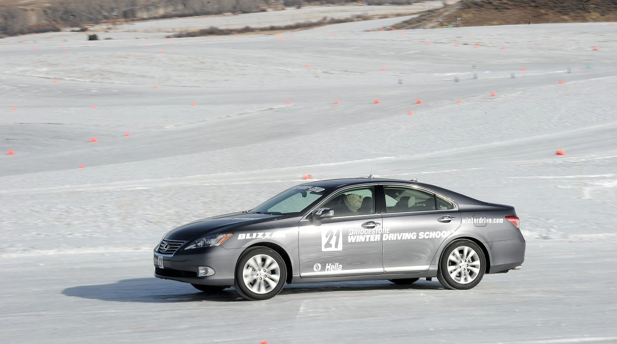 The slick surface of the Bridgestone Winter Driving School tests Phylliss Johnson's driving skills during a class Wednesday morning at the track just outside Steamboat Springs.