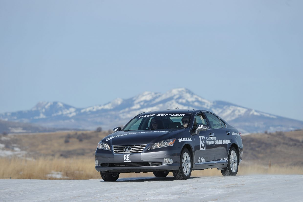 Ava King and passenger Christine Walsh speed along the track at the Bridgestone Winter Driving School on Wednesday.
