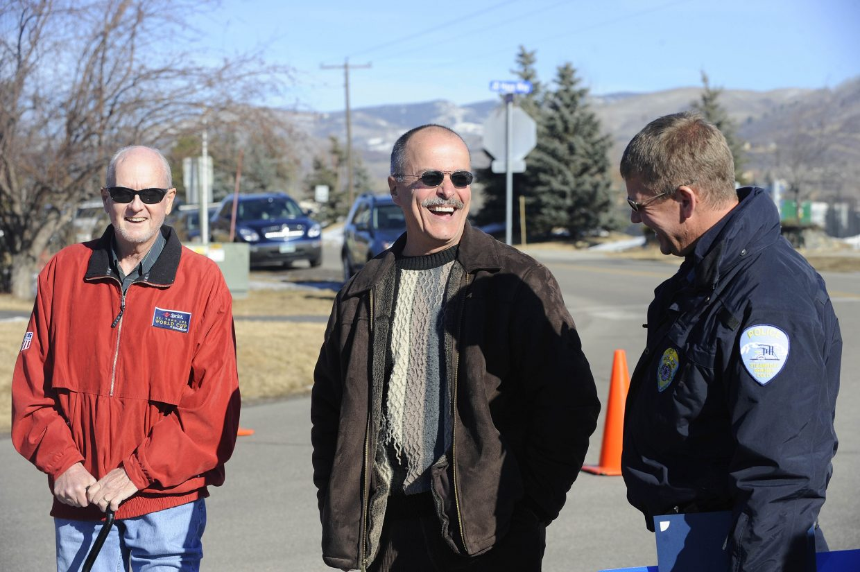 Retiring Steamboat Springs police Chief JD Hays, middle, laughs with his successor, Capt. Joel Rae, right, and former Steamboat Springs City Manager Paul Hughes on Thursday during a ceremony in which a street was renamed JD Hays Way.