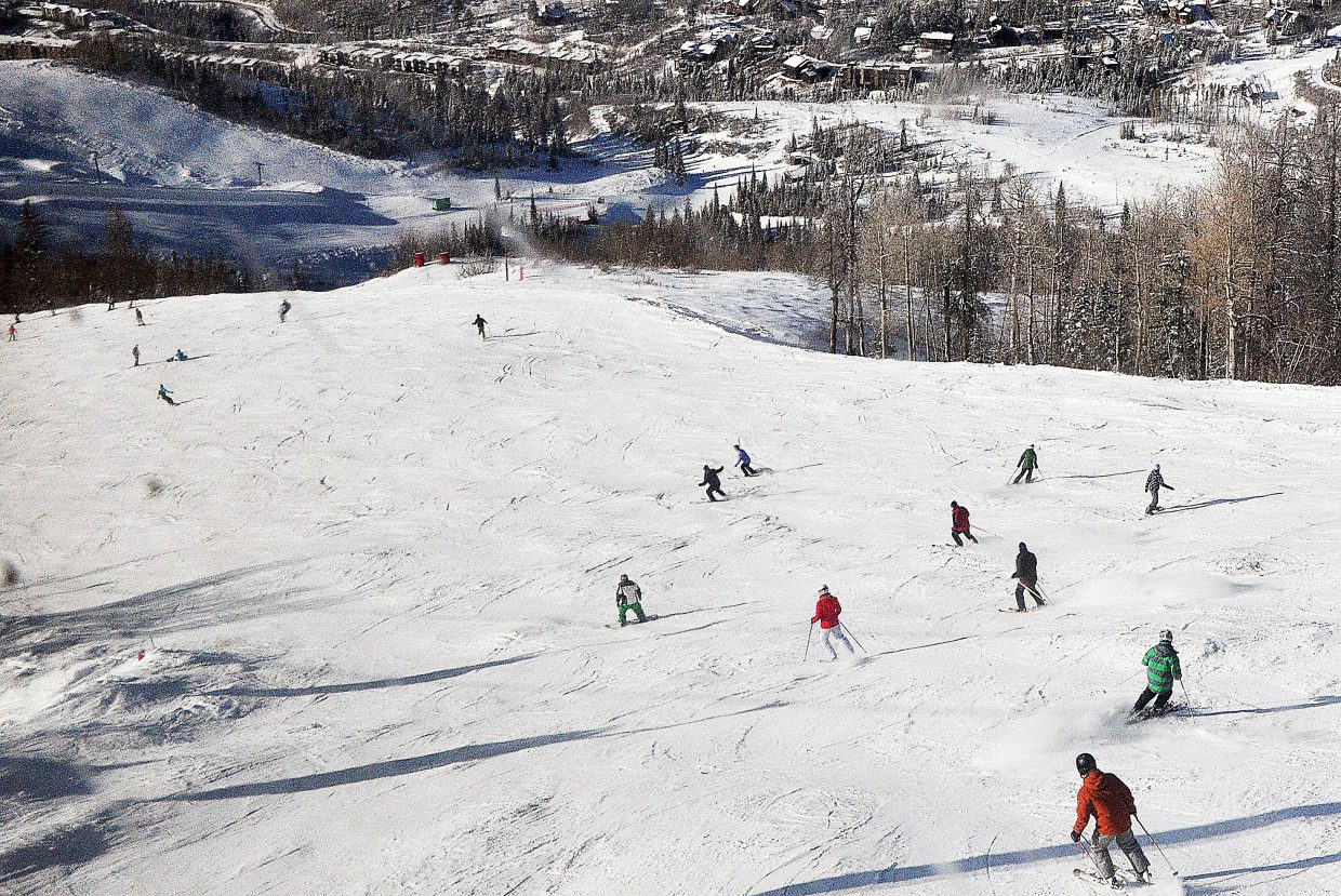 Skiers ride down Heavenly Daze on Sunday at the Steamboat Ski Area.