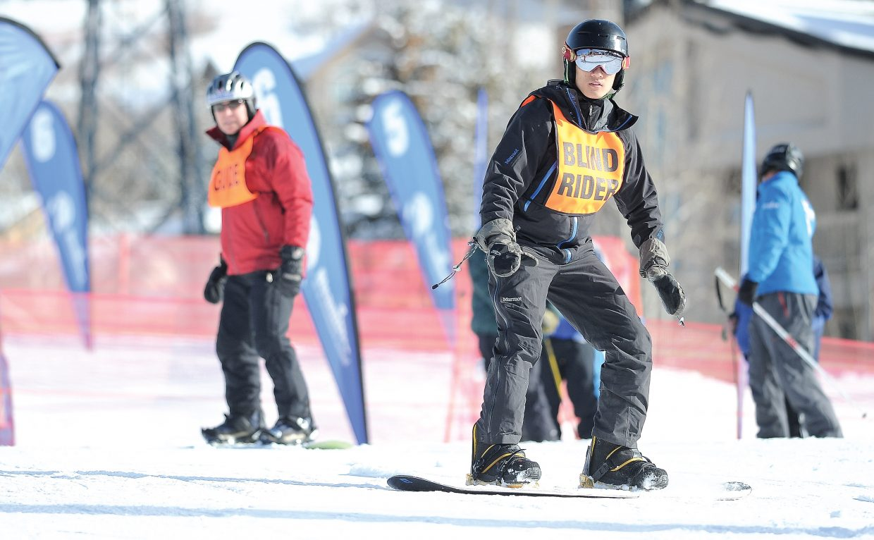 Steve Baskis works with STARS, Steamboat Adaptive Recreational Sports, on a beginners run at Steamboat Resort in 2012. After sending and signing a letter to the nonprofit's board of directors, more than 20 volunteers were terminated by the organization.