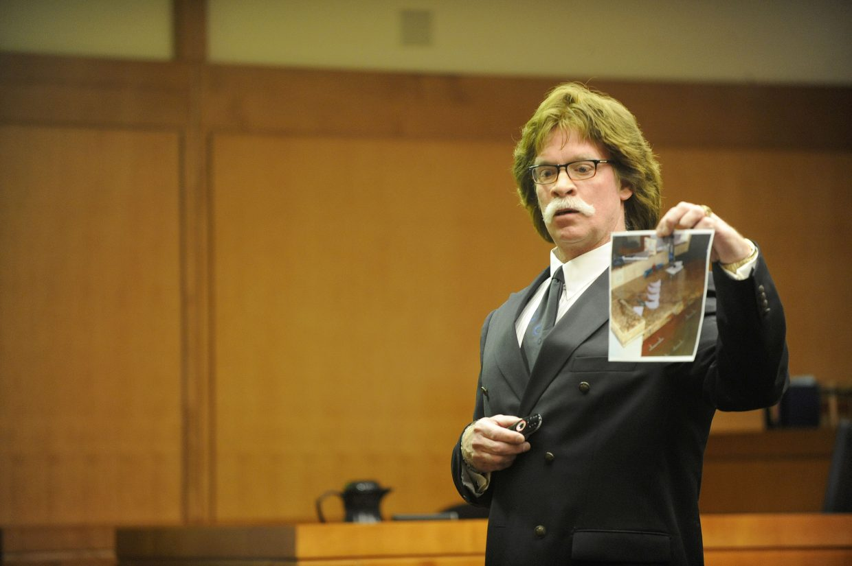 Routt County Chief Deputy District Attorney Rustly Prindle shows jurors a picture of suicide notes he said were written by Robert Cash and found in the kitchen of his home.