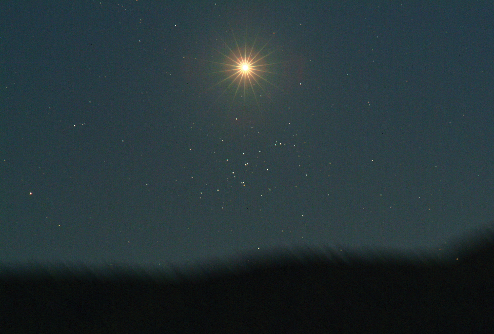 """Venus blazes in our sky this season as our evening star. On June 20, 2010, Venus passed through the Beehive star cluster, as seen in this image. A similar event will happen on April 2 and 3 when Venus passes through the Pleiades, or """"Seven Sisters,"""" star cluster."""